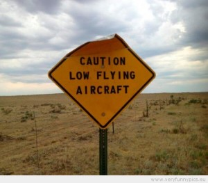 funny-picture-sign-saying-caution-low-flying-aircraft-